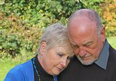 image of grief  - A grief stricken couple outside - JPG