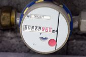 stock photo of water shortage  - the water meter inbuilt in a walls - JPG