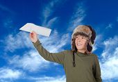 Airman Young playing with a paper airplane with the sky background poster