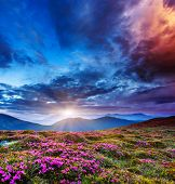 stock photo of storms  - Majestic sunset in the mountains landscape - JPG