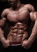 picture of six pack  - Muscled male torso with strong abs in studio - JPG