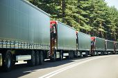 image of truck-cabin  - Lorry trucks cars in traffic jam at border zone custom - JPG
