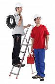 image of osha  - Two electrician about to start work - JPG