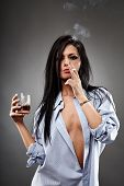 stock photo of debauchery  - Sensual young woman in a man - JPG