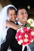 image of wedding arch  - A beautiful bride and handsome groom at church during wedding - JPG