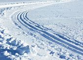 stock photo of nordic skiing  - Nordic skiing trails curve snowy winter sports track - JPG