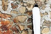 stock photo of waterspout  - Old drain pipe with frozen water against the wall - JPG