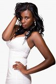 stock photo of tight dress  - Attractive young African American woman wearing tight dress over white - JPG