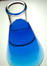 pic of pyrex  - laboratory flask with blue liquid on a white background - JPG