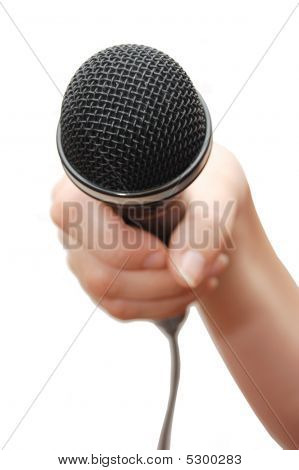 Woman's Hand Holding A Microphone On White Background