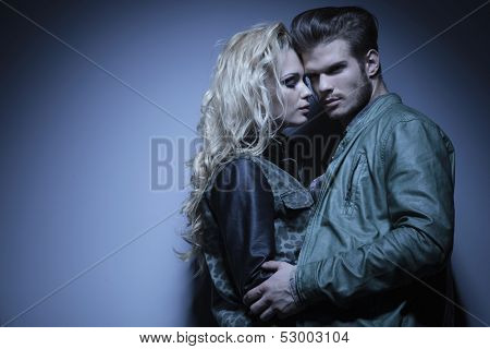 dramatic in love couple standing embraced and posing