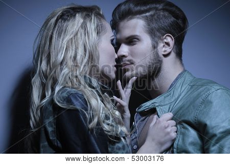 closeup picture of a young couple looking at each other with passion and getting ready to kiss