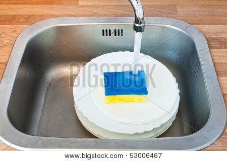 Washing-up By Dish Sponge