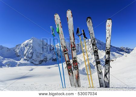 Skiing, winter season , mountains and ski equipments on ski run
