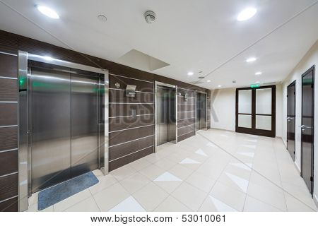 MOSCOW - MAR 14: Three chrome elevator in the hallway at home in Sokolniki on March 14, 2013 in Moscow, Russia.
