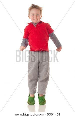Cute Blond Boy Jumping