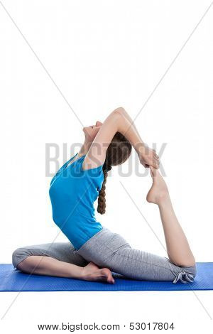 Yoga - young beautiful woman yoga instructor doing King Pigeon Pose (Raja Kapotasana) exercise  isolated on white background