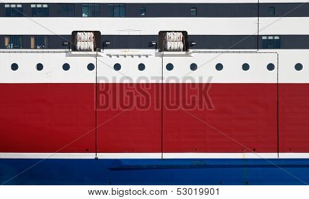 Background Texture Photo Of Red Ship's Hull With Waterline, Portholes And Life Rafts
