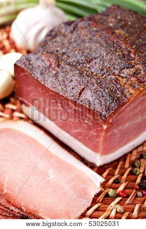 Italian speck on a wooden table
