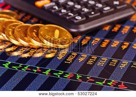 Golden Coins, Calculator And Chart. Selective Focus