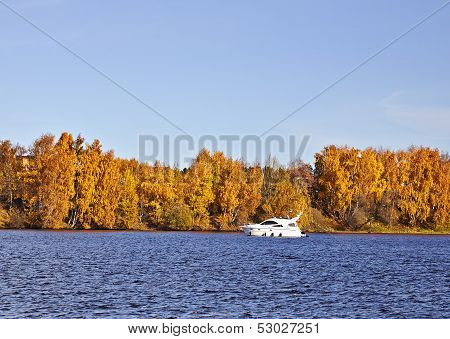 Motorboat On An Autumn Lake