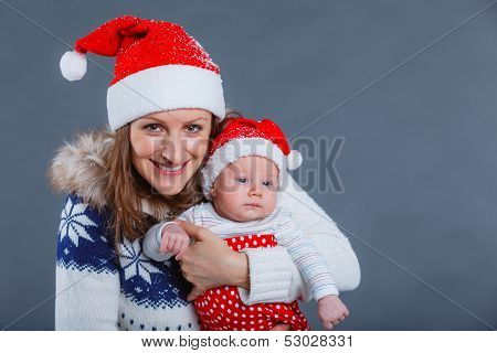 Portrait of happy family in Santa's hat