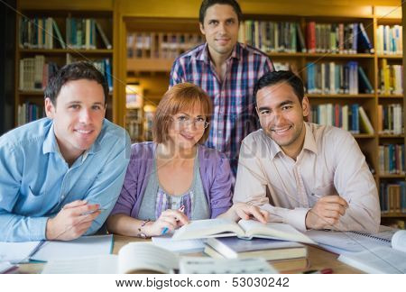 Portrait of four mature students studying together in the library