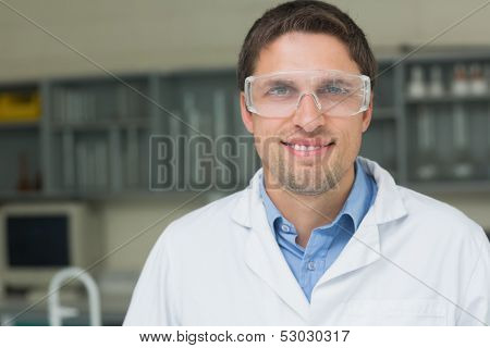 Close-up portrait of a confident male doctor wearing surgical glasses in medical office