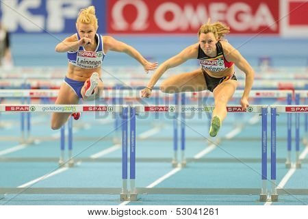GOTHENBURG, SWEDEN - MARCH 1 Eline Berings (Belgium) places 3rd in heat 1 of the women's 60m hurdles event during the European Athletics Indoor Championship on March 1, 2013 in Gothenburg, Sweden.