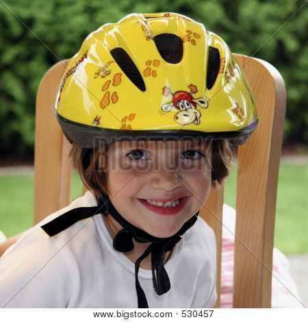 Young Child With Bicycle Helmet In Yellow