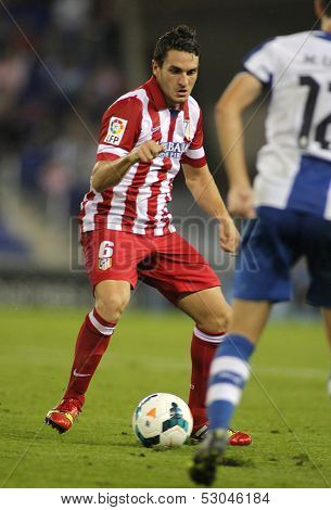 BARCELONA - OCT, 19: Koke Resurreccion of Atletico de Madrid in action during a Spanish League match against RCD Espanyol at the Estadi Cornella on October 19, 2013 in Barcelona, Spain