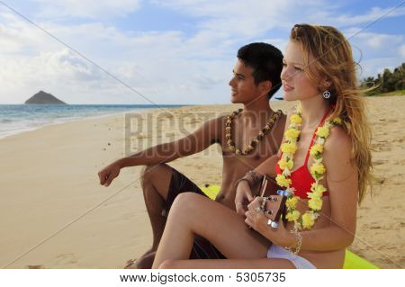 Girl On A Surfboard On The Beach Playing Ukulele For Boyfriend