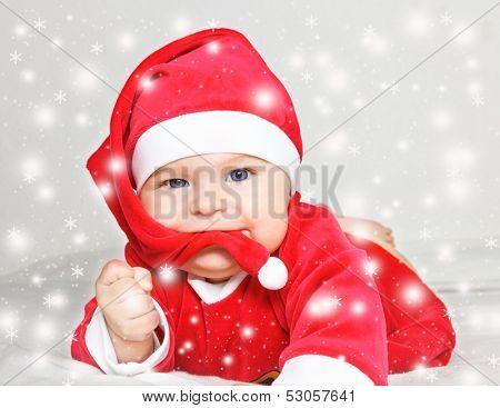 Baby Santa Claus in snowstorm