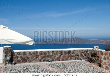 Stone Patio View Of Volcanic Islands Santorini Greece