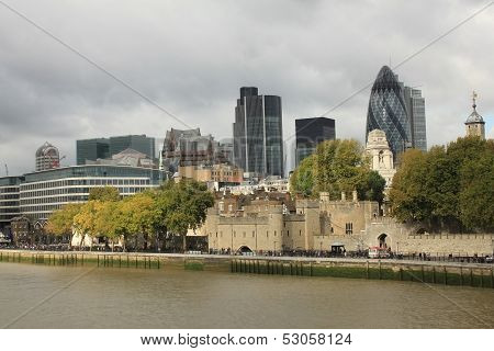 Tower Of London And Modern London City Office Skyline By River Thames