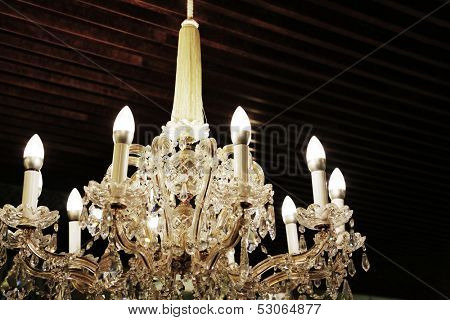 grunge grey background with crystal-candelabra.