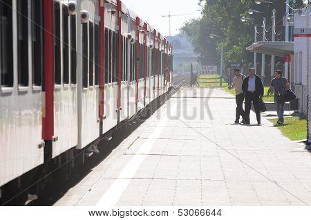 Passenger train arrives to R. S. Ortiz station.