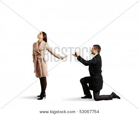 young handsome man making proposal of marriage, but young woman is refusing him. isolated on white background