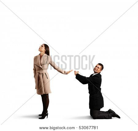 sad man apologizing to young beautiful woman. isolated on white background