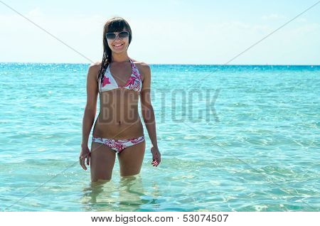 Joyous Slim Woman In Bikini Standing In Water And Enjoying The Sun. Copyspace