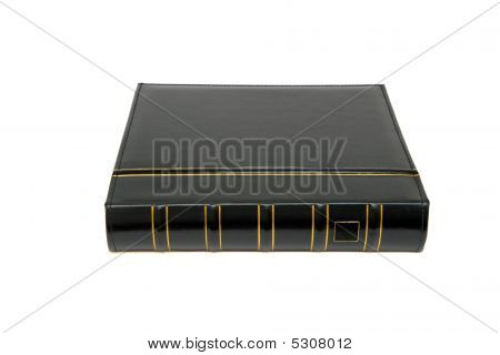 Thick Black Book With Gold Trimming Isolated