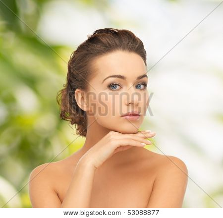 health and beauty, green, eco, bio concept - face and hands of beautiful woman with updo (can be used as a template for jewelry)