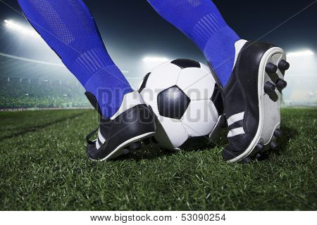 Close up of feet kicking the soccer ball