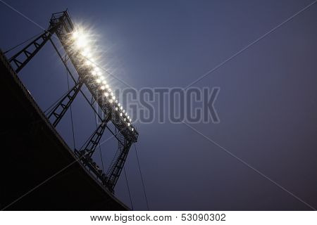 Stadium floodlights at night time