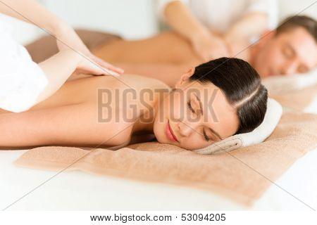 health and beauty, resort and relaxation concept - couple in spa salon getting massage