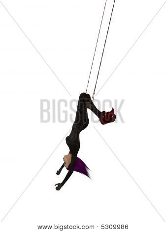 Clown Hanging Upside Down On A Trapeze