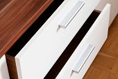 stock photo of guest-house  - open drawers of linen cupboard close up - JPG