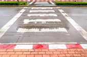foto of zebra crossing  - Crosswalk in the city after rain - JPG