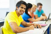 stock photo of indian  - good looking indian college student in lecture room - JPG