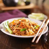 stock photo of chopsticks  - pad thai with chicken dish - JPG